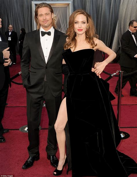 Oscars go back to black and white angelina wows with thigh high split