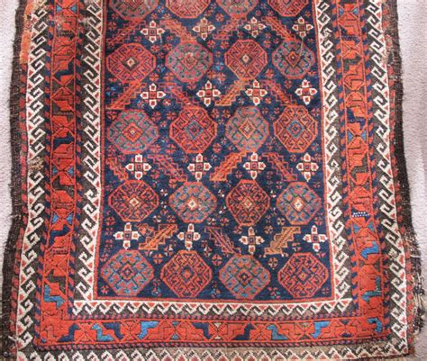 arabian rugs arab baluch rug asymmetrical knot open right but with 4 chord goat selvedge running