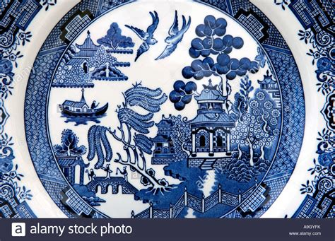 blue pattern crockery traditional willow pattern design on an english blue and