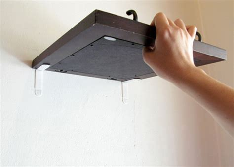 how to hang a canvas without nails how to hang art without nails jennifer squires productions