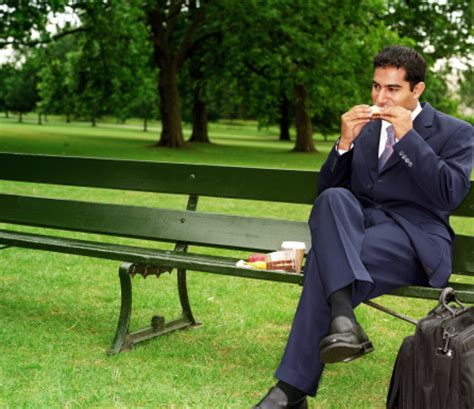 eating bench businessman eating lunch on park bench stock photo getty