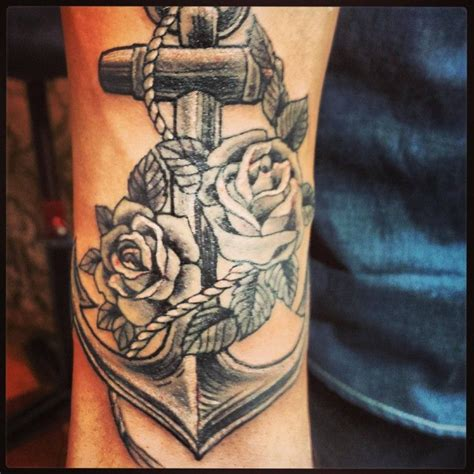anchor tattoo with roses grey ink flowers and anchor tattoooos