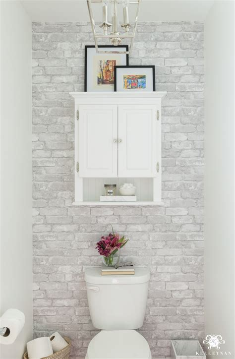 toilet room makeover reveal and clever bathroom storage