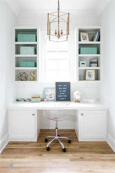 white home office white built in desk with tiffany blue acccents