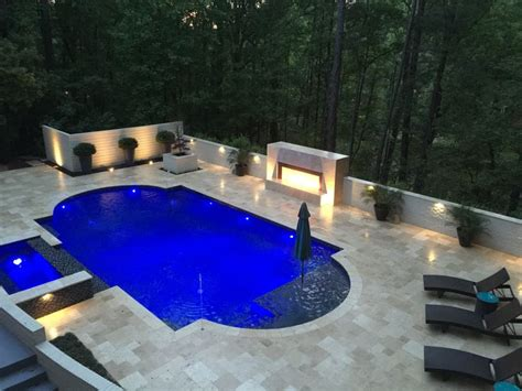 night view of roman style swimming pool with deck jets gunite double roman pool 3