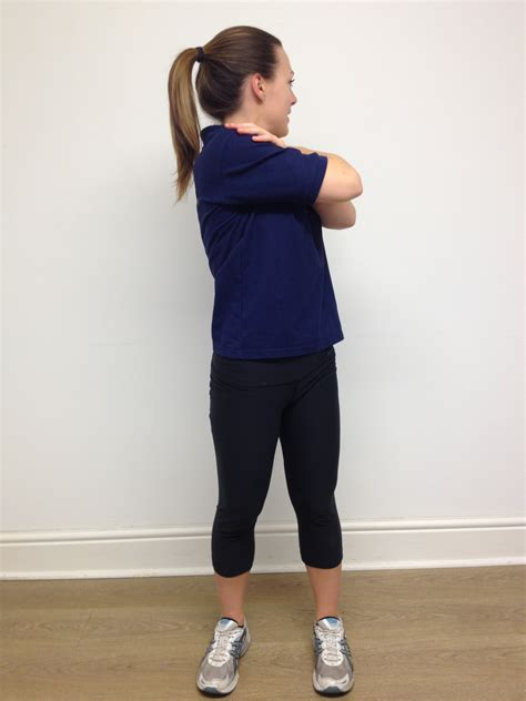 thoracic spine mid  rotation stretch standing  physiotherapy fitness