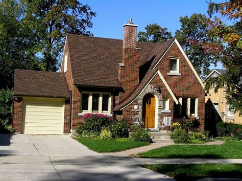 english cottage style house english style architecture older bungalow home with curved asymmetrical gable