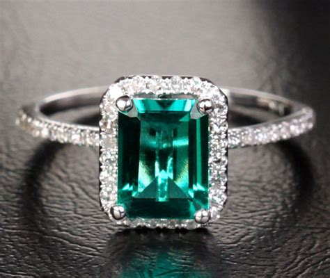 2 33ct emerald 9 18k white gold pave 23ct halo