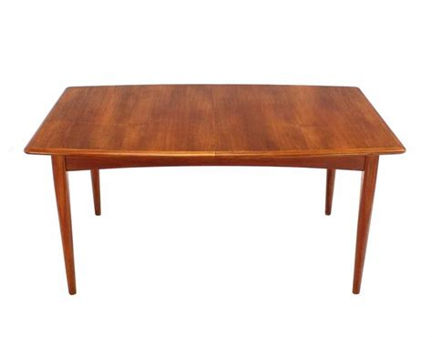 modern teak boat shape dining table with two pop up