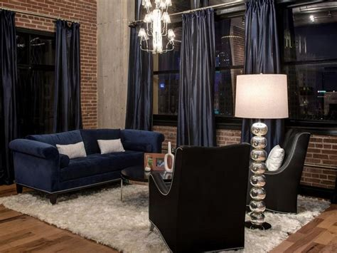 navy blue curtains and sofa combine with black leather