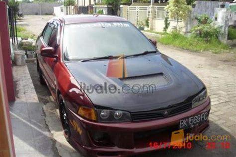 Tv Mobil Lancer mitsubishi lancer evo iv merah modifikasi jualo