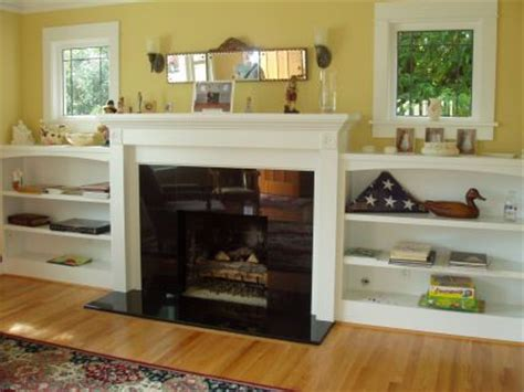 custom built in fireplace niche or recessed bookshelves