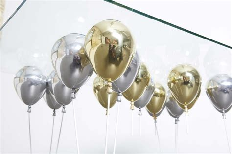 Suspended by shiny gold and silver balloons up dining table freshome com