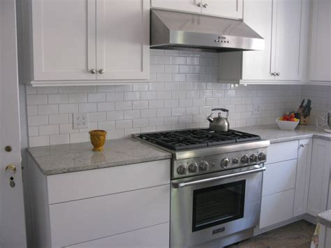 subway tile kitchen backsplashes kitchen kitchen glass white subway tile backsplash ideas hoods wooden flooring gas stove and