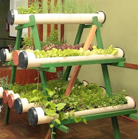 low budget garden ideas by using the pipes as the media of