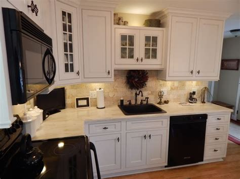 omega kitchen cabinets with a corian witch hazel counter