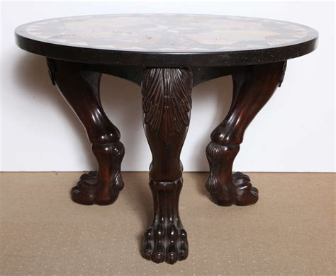 coffee table with carved legs and specimen marble