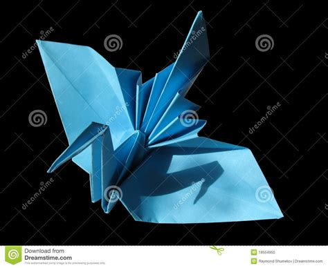 Festive Origami - origami festive crane isolated on black stock photo