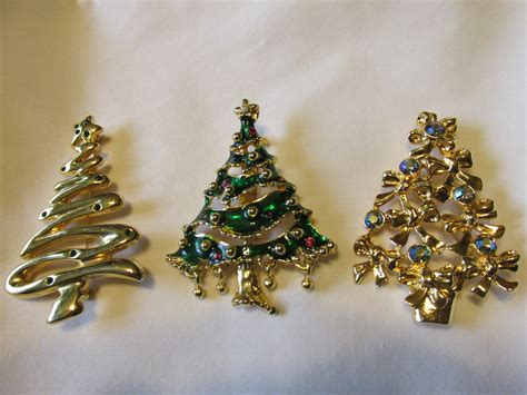 three vintage christmas tree pins with rhinestones