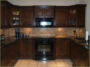 Colored kitchen cabinets with black appliances home design ideas
