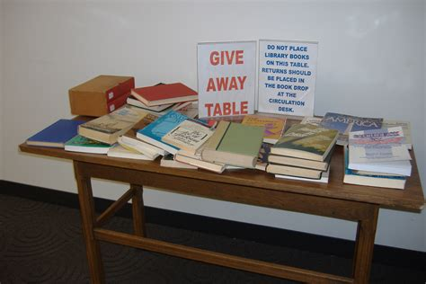 exchange books at the give away table crown library