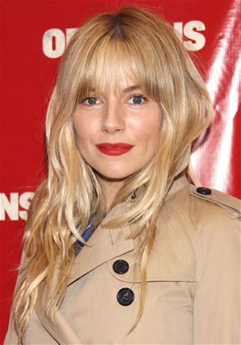 photos sienna miller haircut sienna miller bangs sienna miller s long wavy hairstyle with blunt bangs