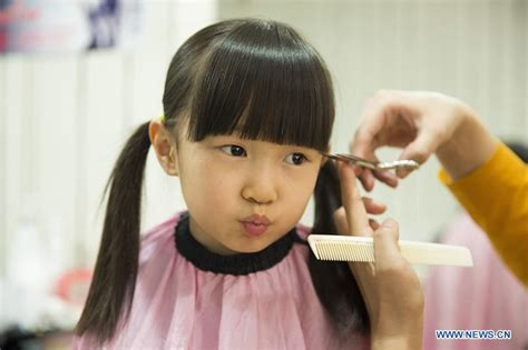 chinese haircuts games for kids chinese kids get lucky haircuts china org cn