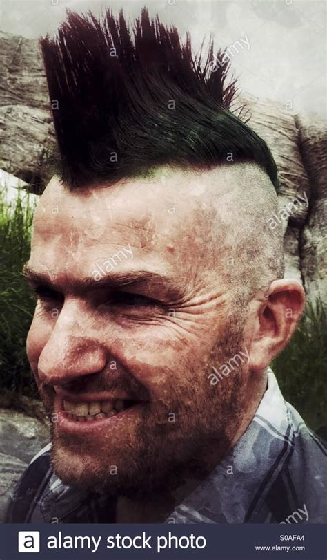 middle aged mohawk smiling middle aged man with a mohawk hairdo stock photo