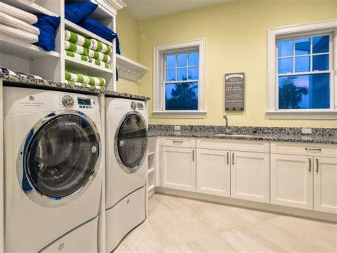 yellow laundry room  hgtv