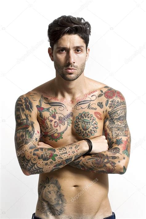 handsome tattooed portrait with crossed arms stock