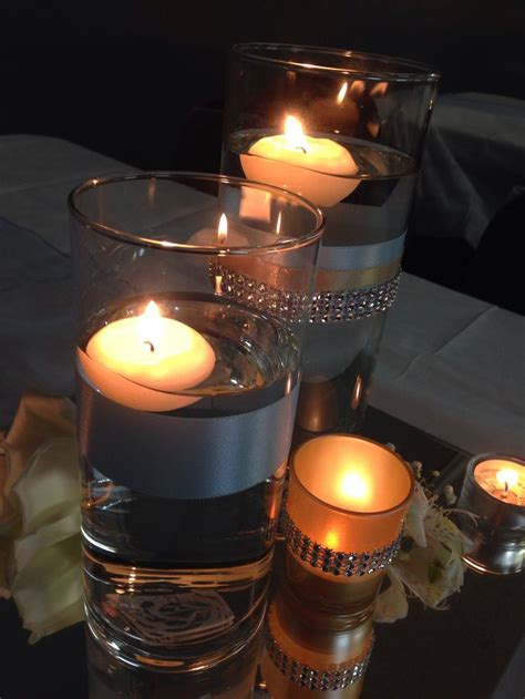 table mirror centerpiece guest table setting baby blue and chagne wedding we used floating candles in cylinder vases