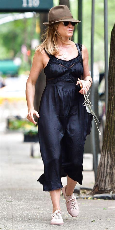jennifer aniston wears  curve flattering black dress