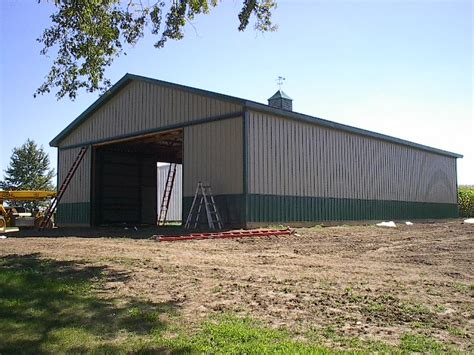 Machine Shed by Roofing Installation And Pole Bar Construction