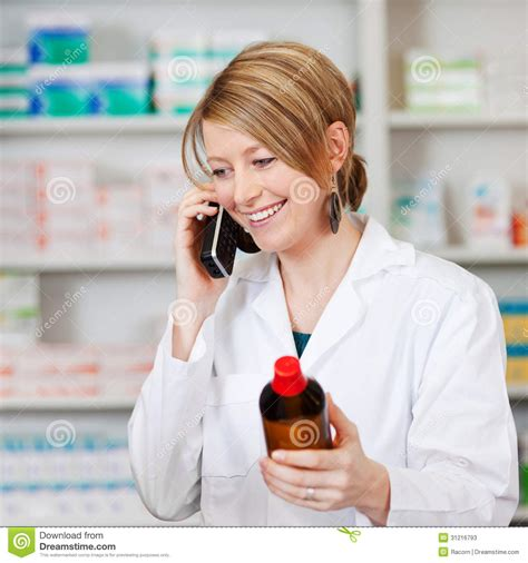 Call Pharmacy by Pharmacist Holding Medicine Bottle While On Call In