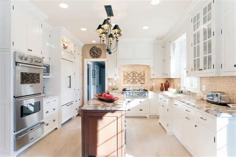 plain and fancy kitchen cabinets cottage kitchen cabinetry dressed in white traditional