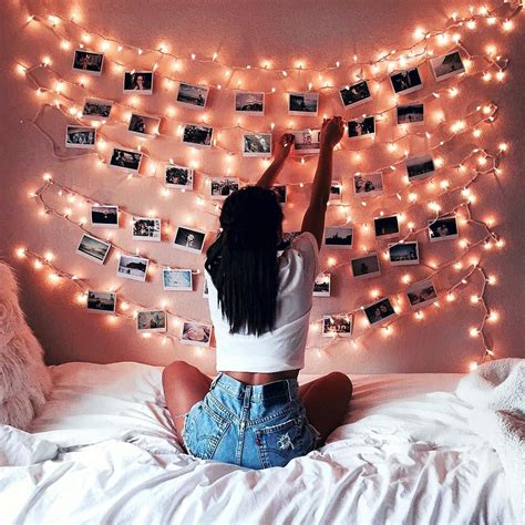 fairy lights girls bedroom decoration with fairy lights and photos on a pink wall