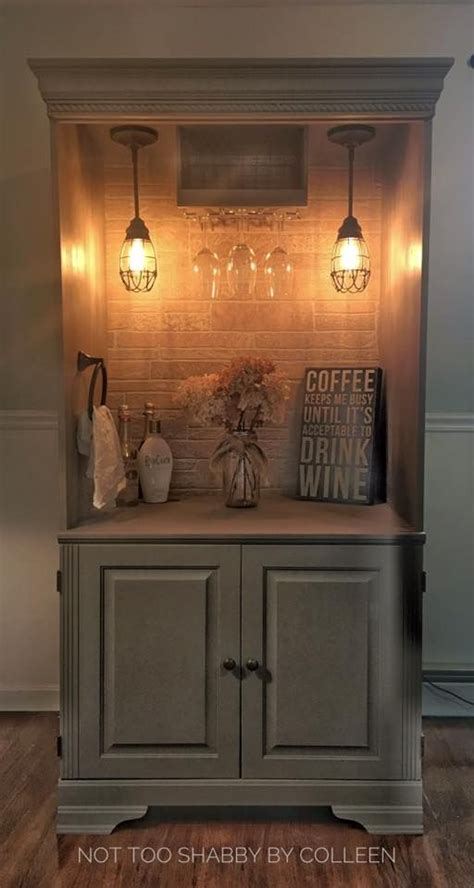 repurposed wardrobe armoire converted to a lighted dry bar by not too shabby by colleen my