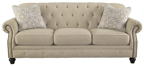 tufted back sofa signature design kieran traditional sofa with