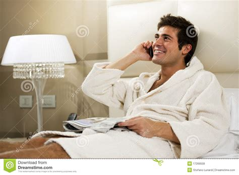 guy in bed relaxed man in bed stock photo image of positivity