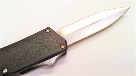otf knives black dual edge lightning otf knife