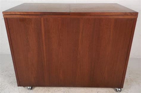 mid century modern walnut and rosewood hall cabinet for mid century modern rosewood and walnut flip top bar by
