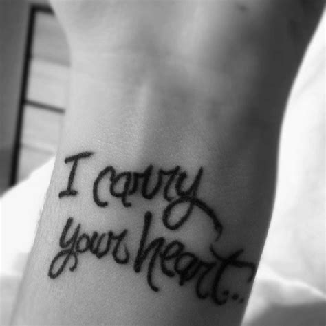 i carry your heart tattoo designs i carry your by e e on my left