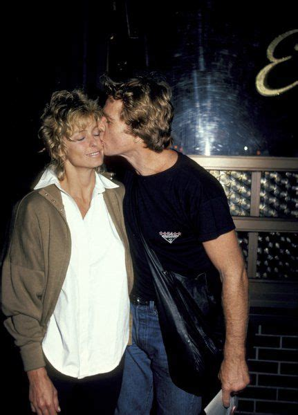 love love the and farrah fawcett on pinterest farrah fawcett gets a kiss from boyfriend ryan o neal