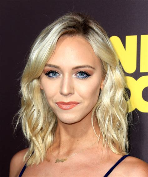 paige mobley medium wavy casual hairstyle light blonde