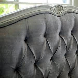 grey tufted headboard with detailed carved trim lovely