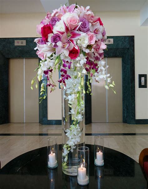 centerpiece 31 quot height vase with a white dendrobium