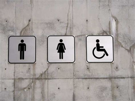 bathroom stall signs nyc requires businesses to replace men women single
