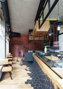 hexagon tiles transition into wood flooring inside this cafe in greece contemporist