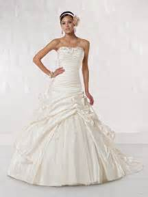 Princess wedding dress features a beaded ruched bodice and a pick up
