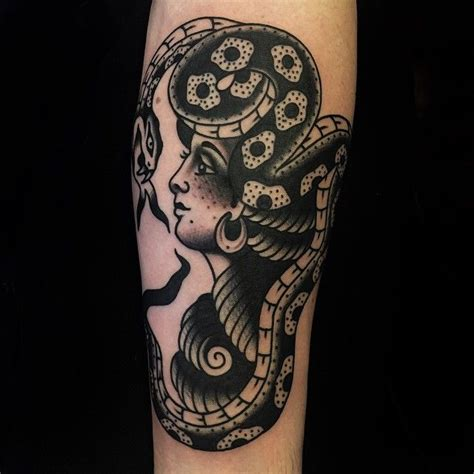 black ink traditional lady head with snake tattoo